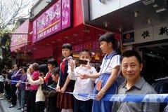 Shenzhen china: temple worship activities. In March 19th, 2012, Shenzhen Xixiang pedestrian street, Pak Tai Temple worship activities. People took to the streets Royalty Free Stock Image