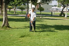 Shenzhen, China: to mow the lawn Stock Images