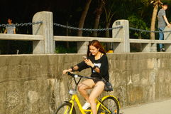 Shenzhen, China: tourists travel by bike in Shenzhen Bay Park Royalty Free Stock Photography