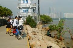 Shenzhen, China: tourists travel by bike in Shenzhen Bay Park Stock Photo