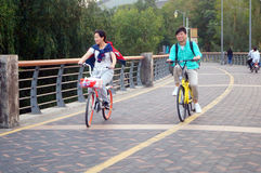 Shenzhen, China: tourists travel by bike in Shenzhen Bay Park Royalty Free Stock Images