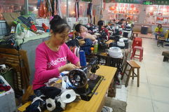 Shenzhen, China: traditional sewing machine, mending clothes Royalty Free Stock Image