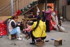 Shenzhen, China: Traditional street clothes sewing repair Stock Photography