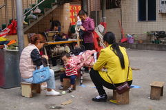 Shenzhen, China: Traditional street clothes sewing repair Stock Photo