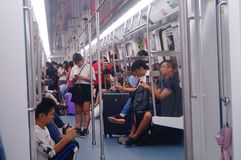 Shenzhen, China: the traffic scene of metro line 1. Some men and women are looking at their mobile phones, some are talking and so. Shenzhen metro line 1 traffic royalty free stock photos