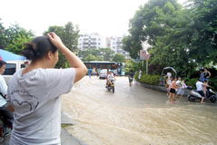 Shenzhen china: underground water pipes burst, water flow into the river Royalty Free Stock Photo