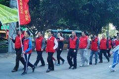 Shenzhen, China: Volunteers in activities Stock Photos