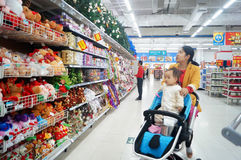 Shenzhen, China: Wal-Mart. Baoan District, Shenzhen, Wal-Mart, Christmas is coming, the young mother took the children to buy Christmas gifts royalty free stock images