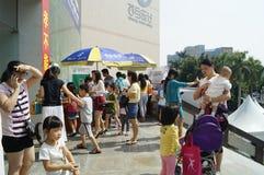 Shenzhen, China: watch the movie with parents and children. Shenzhen Baoan Xixiang cinema, watching a movie in a lot of parents and children. This is a Stock Photo