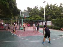 Shenzhen, China: weekend, office workers are playing basketball fitness Royalty Free Stock Photo