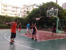 Shenzhen, China: weekend, office workers are playing basketball fitness Royalty Free Stock Photos