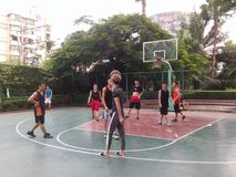 Shenzhen, China: weekend, office workers are playing basketball fitness Stock Photography