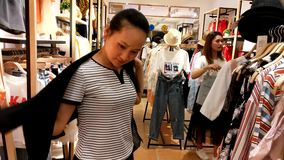 Shenzhen, China: women buy clothing and bras at a clothing store. Young women shop in clothing stores for clothes, bras, etc stock video