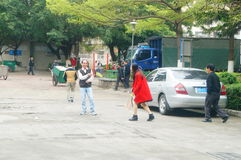 Shenzhen, China: women and children play badminton together Stock Photo