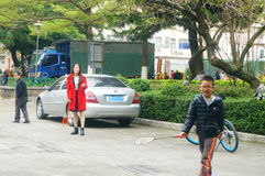 Shenzhen, China: women and children play badminton together Royalty Free Stock Photos