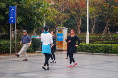 Shenzhen, China: women dance happily in the square Stock Photos