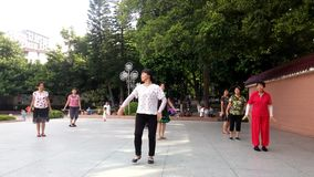 Shenzhen, China: women are dancing and exercising stock video footage