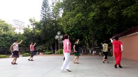 Shenzhen, China: women are dancing and exercising stock footage