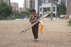 Shenzhen, China: Women picking up waste products Royalty Free Stock Images