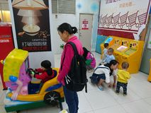 Shenzhen, China: women play with their children at an amusement park royalty free stock photo