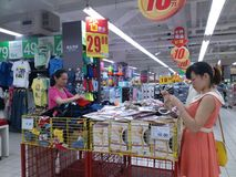 Shenzhen, China: women shopping for goods in shopping malls Royalty Free Stock Image