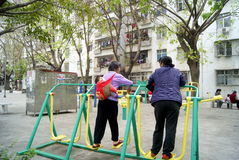 Shenzhen china: women in for sports. On March 1, 2013, shenzhen buji nanling garden village, there are two women doing leisure sports. One of the women also Stock Photos