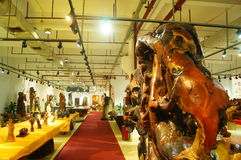 Shenzhen, China: wood carving crafts exhibition sales Stock Images
