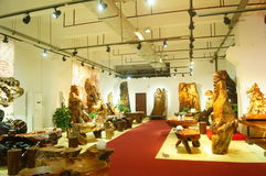 Shenzhen, China: wood carving crafts exhibition sales Stock Photos