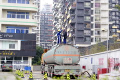 Shenzhen china: the worker on the fuel tank Royalty Free Stock Image