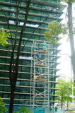 Shenzhen, China: workers clean glass curtain wall in high-rise building Royalty Free Stock Photos