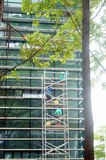 Shenzhen, China: workers clean glass curtain wall in high-rise building Stock Images