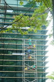 Shenzhen, China: workers clean glass curtain wall in high-rise building Royalty Free Stock Photo
