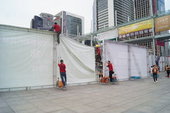 Shenzhen, China: workers erected billboards Stock Images