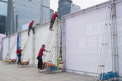 Shenzhen, China: workers erected billboards Royalty Free Stock Photos