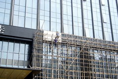Shenzhen, china: workers in the glass of a high building wall construction Royalty Free Stock Image