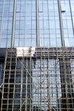 Shenzhen, china: workers in the glass of a high building wall construction Royalty Free Stock Photo