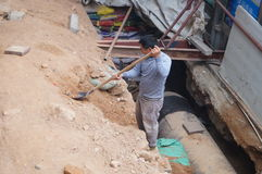 Shenzhen, China: Workers installing water pipes. Baoan District, Shenzhen, a worker is installing water pipes. This is the urban water supply facilities update Stock Images