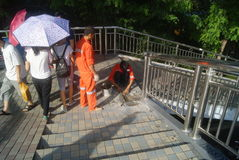 Shenzhen, China: workers in pavement repairing Stock Photography