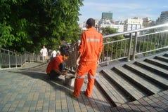 Shenzhen, China: workers in pavement repairing Stock Photos