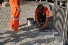Shenzhen, China: workers in pavement repairing Royalty Free Stock Image