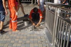 Shenzhen, China: workers in pavement repairing Stock Images