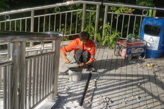 Shenzhen, China: workers in pavement repairing Royalty Free Stock Images
