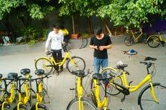 Shenzhen, China: workers repair shared bikes Royalty Free Stock Photography
