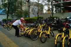 Shenzhen, China: workers repair shared bikes Stock Image