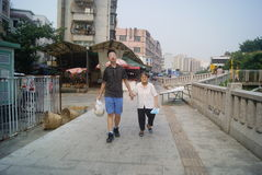 Shenzhen, China: young boys hand hold old women walk Stock Photography