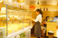 Shenzhen, China: young female employees in bakery Stock Photos