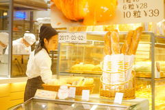 Shenzhen, China: young female employees in bakery Stock Photo