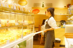 Shenzhen, China: young female employees in bakery Stock Images