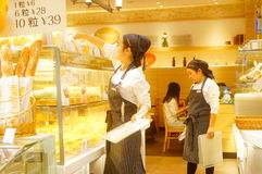 Shenzhen, China: young female employees in bakery Royalty Free Stock Images