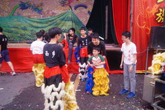 Shenzhen, China: young people dancing lion Royalty Free Stock Image
